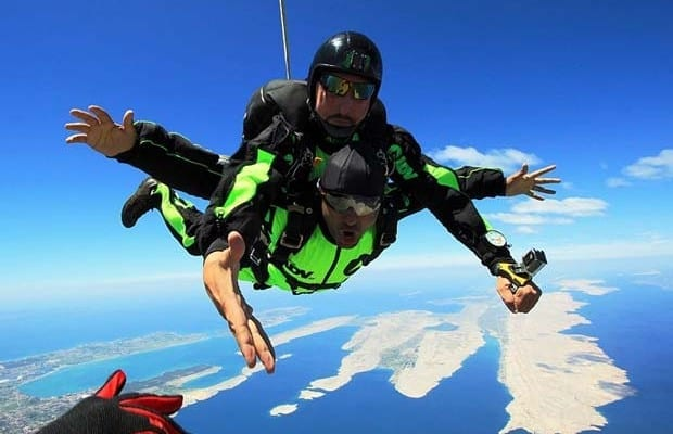 Tandem jump with skydiving cameraman