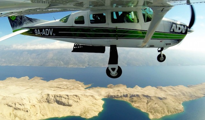 Skydiving airplane Cessna 206 flying over Croatia