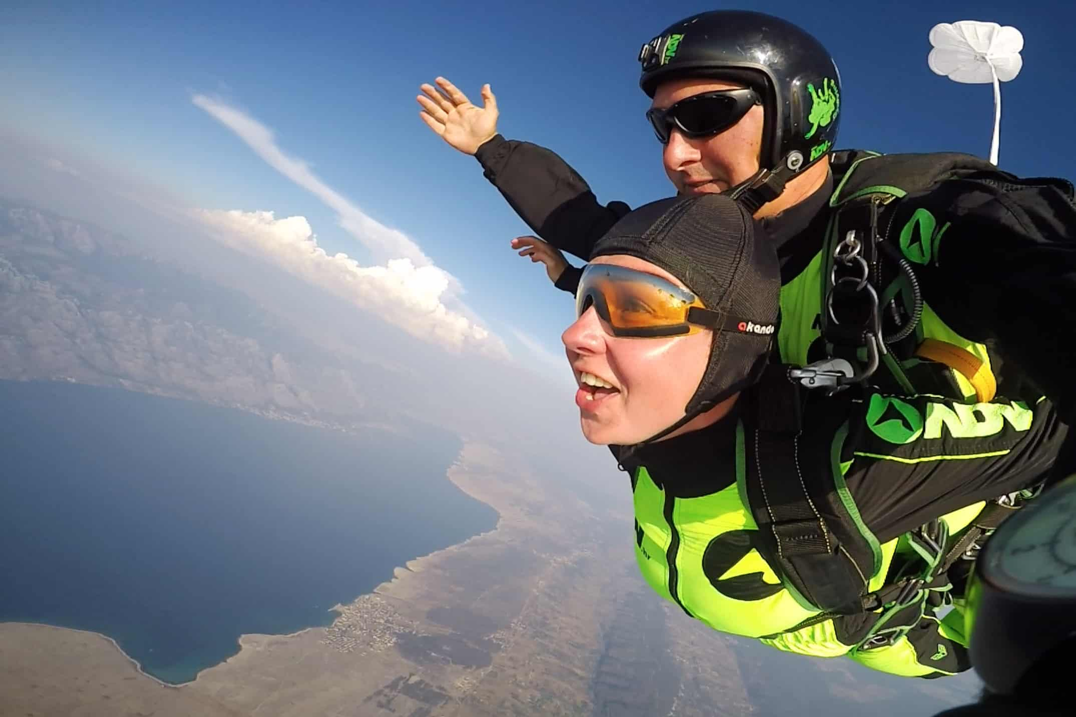 happy tandem skydiver in free fall
